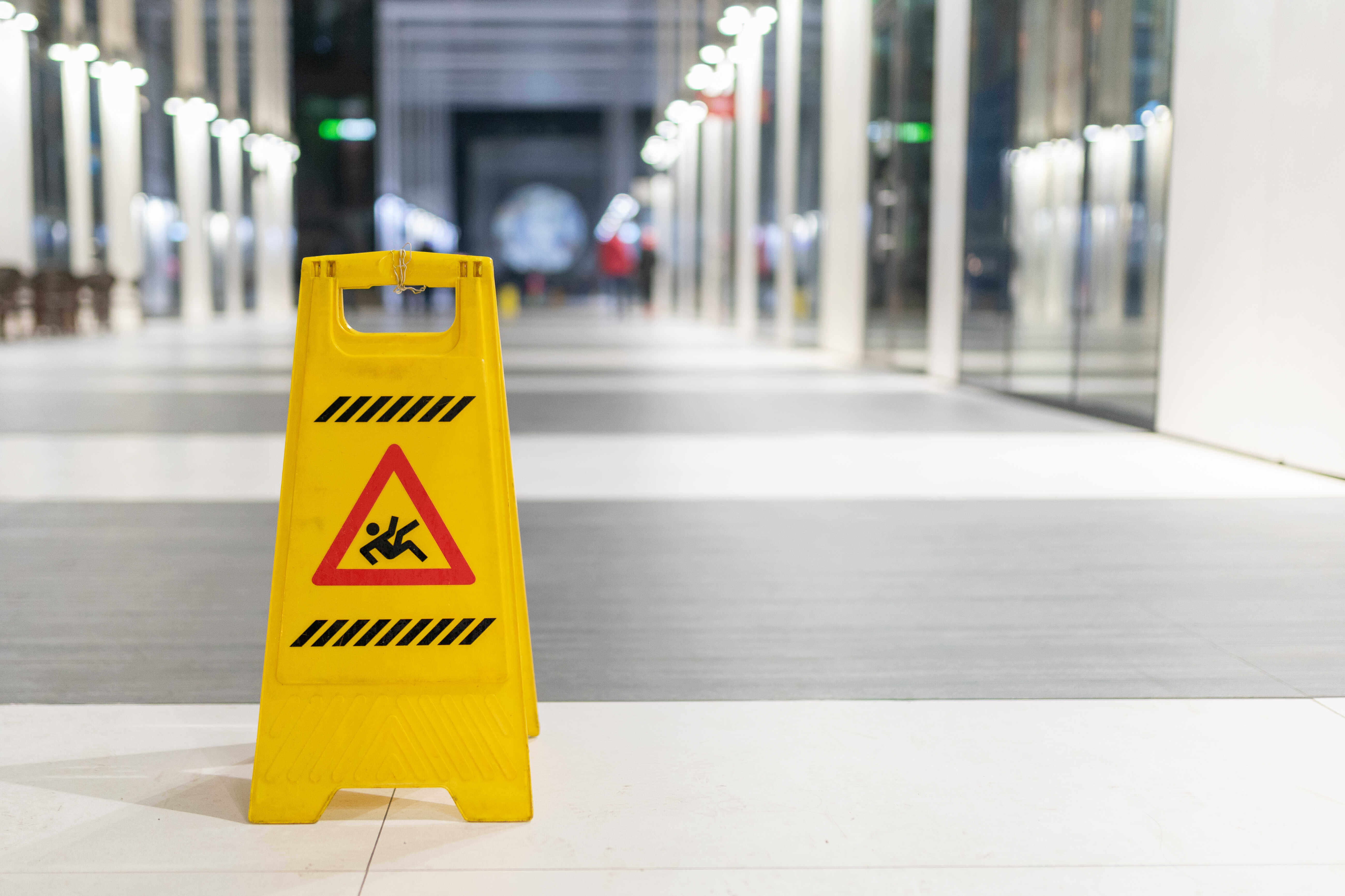 wet floor sign in hallway